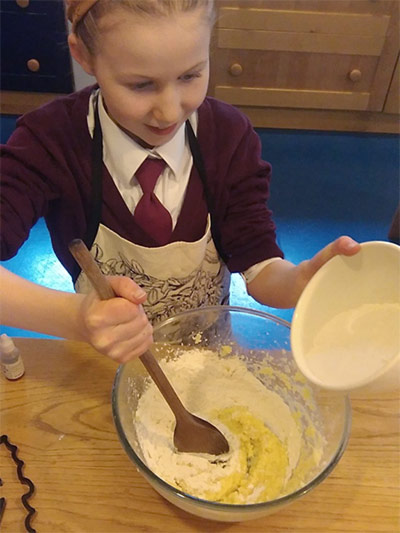 Mixing the dough for bat biscuits
